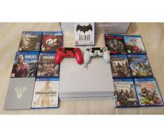 new Sony Ps4 PRO 1TB console with 8 extra games $150